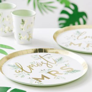 A white and gold paper plate with green flowers on it and the words almost mrs written on top